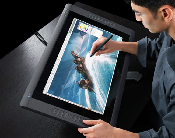 "An artist using a Wacom Cintiq 22"" pen tablet to create a concept sketch. (From http://www.wacom.com/en/us/creative/cintiq-22-hd)"