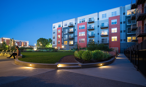 The residential buildings utilize green roofs, bioswales and rain gardens to limit storm water entering the storm sewers. The green space in the courtyard actually sits on top of a parking garage roof.