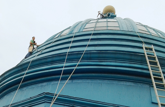 Sean climbing on the historic Motor Square Garden dome for assessment